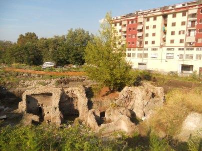The Roman baths lying next to a block of modern flats